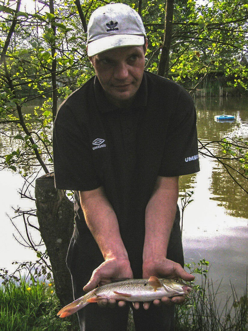 Local angler, Carl Halliwell, with one of our hard fighting Barbel.